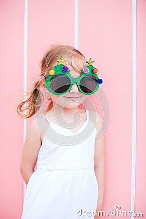 Little girl wearing funny Christmas glasses
