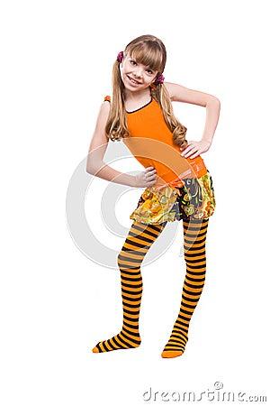 Little girl wearing orange dress is standing