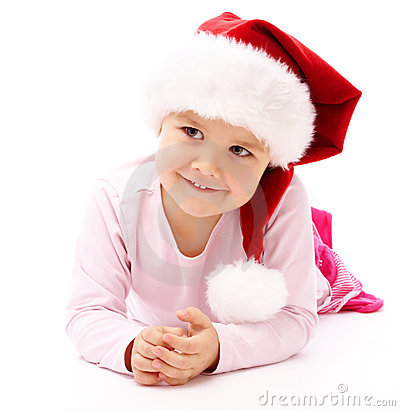 Little girl wearing red Christmas cap