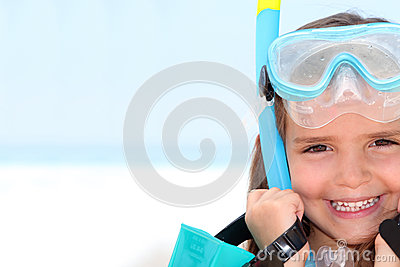 Little girl wearing snorkel