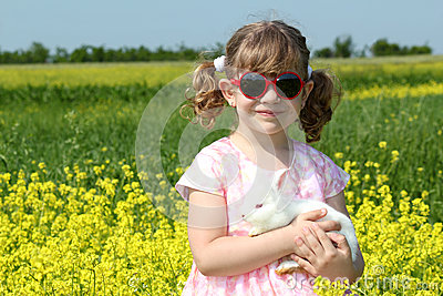 Little girl with white dwarf bunny