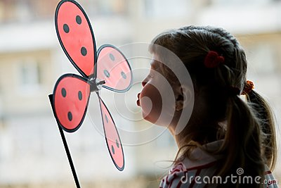 A little girl with a windmill toy