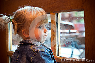 Little girl at window