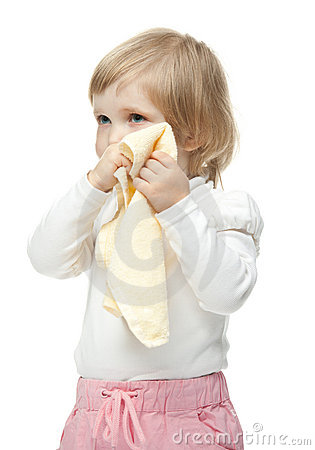 The little girl wiping her face