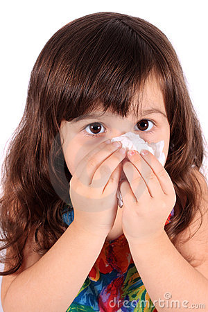 Little girl wiping nose with tissue