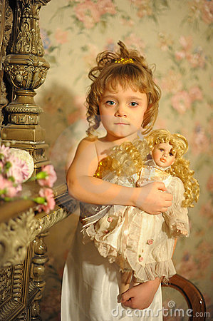 Free Little Girl With A Doll In Hands Stock Photo - 18092680