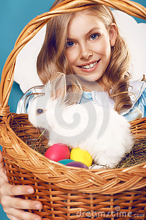 Free Little Girl With Basket With Color Eggs And White Easter Bunny Stock Photo - 52083800
