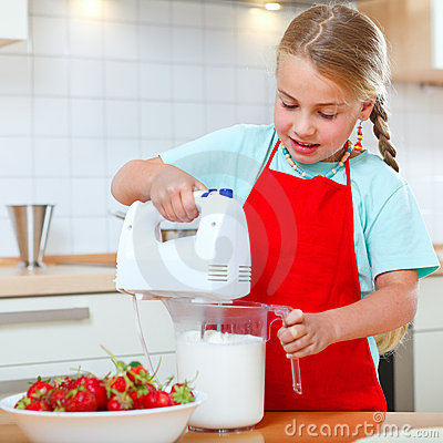 Free Little Girl With Mixer In Kitchen Stock Photo - 22542680