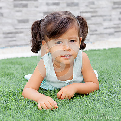Free Little Girl With Pigtails Lying On The Grass Royalty Free Stock Image - 60221666