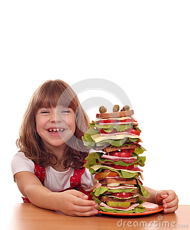 Free Little Girl With Tall Sandwich On Table Royalty Free Stock Photo - 35200245