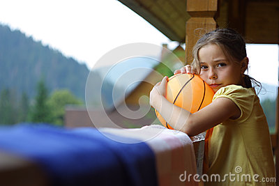 Little girl in the wooden house