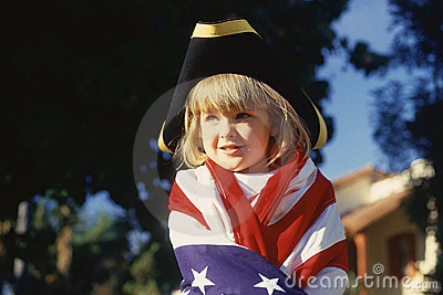 Little girl wrapped in American flag, Editorial Image