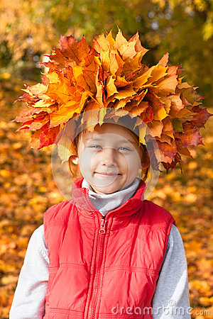 Little girl with  wreath of maple leaves on the head