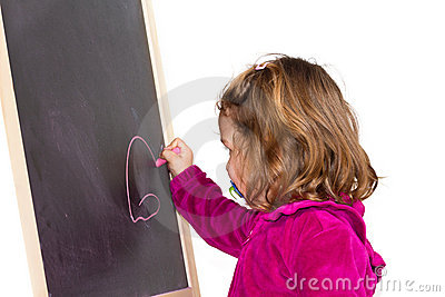 Little girl writing on a blackboard