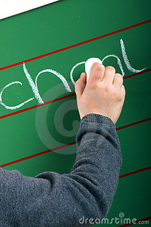 Little girl is writing on a board