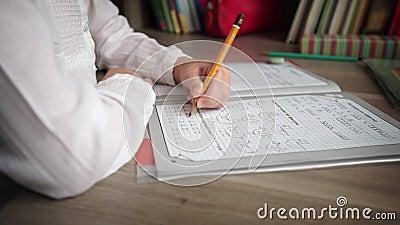 Little girl writing and doing homeworks stock video