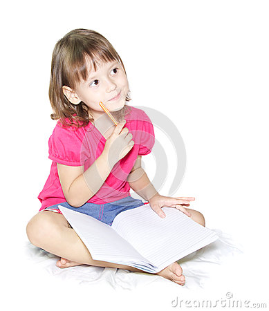 Little girl writing in her book