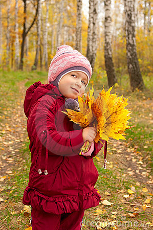 Little girl with yellow leaves