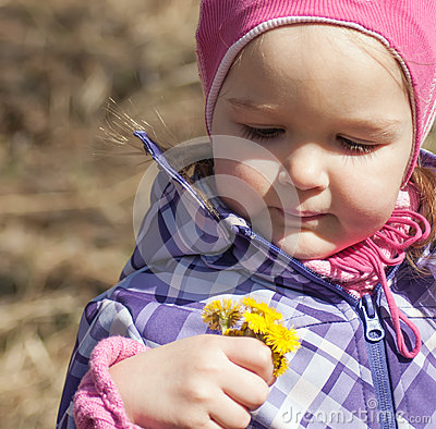 Little girl with yellow spring flowers