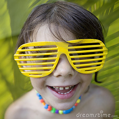 Little girl in yellow sun glasses