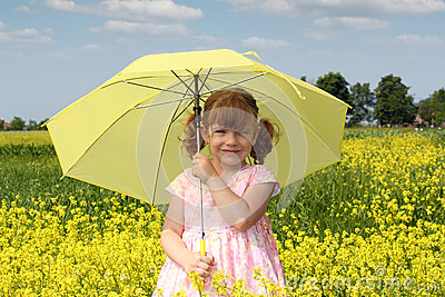 Little girl with yellow umbrella