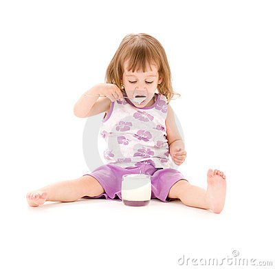 Little girl with yogurt