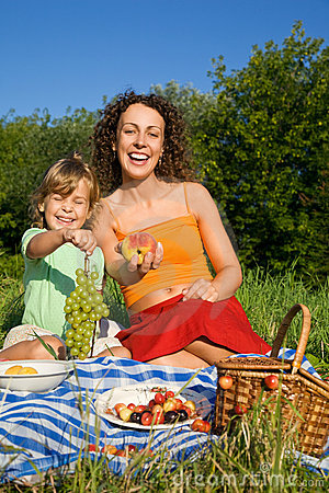 Little Girl and Young Women keeps in hand fruits