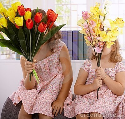 Little girls with bouquet of flowers