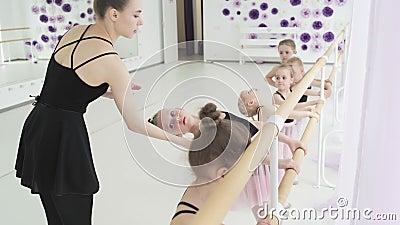 Little girls dance ballet. Children in ballet class. Little ballerinas and teacher. Beautiful view. 4k stock video footage