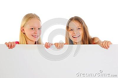 Little girls holding blank sign