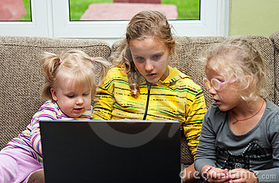 Little girls and laptop