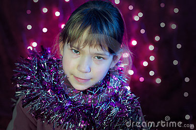 Little girls look with Christmas lights