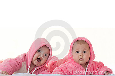 Little girls in pink overalls an isolated white