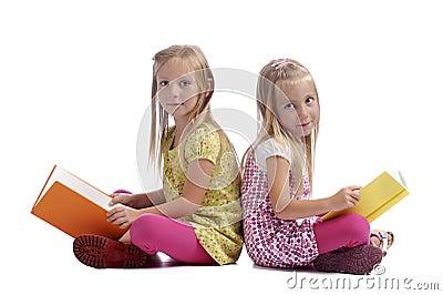 Little girls reading books