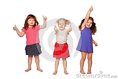 Little girls showing thumbs, OK sign