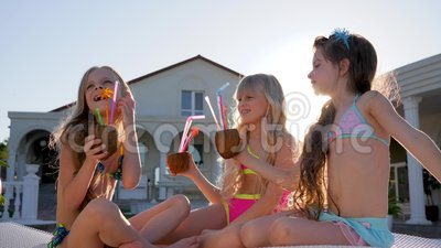 Little Girls in Swimsuit Have Fun Near Villa in Backlight, Rich Kids on Sunbeds with Coconut Cocktail in Hands Outdoor Stock Footage - Video of rich, outdoor: 96841828