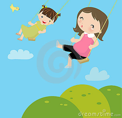Little girls on a swing