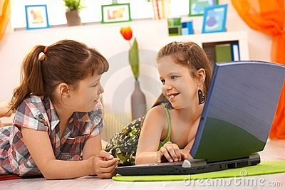 Little girls using computer at home