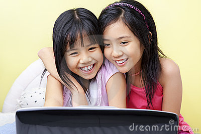 Little girls using laptop