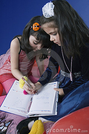 Little girls writing