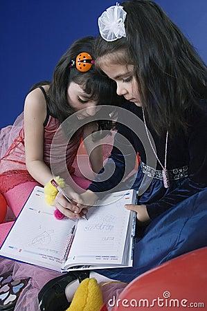 Little girls writing