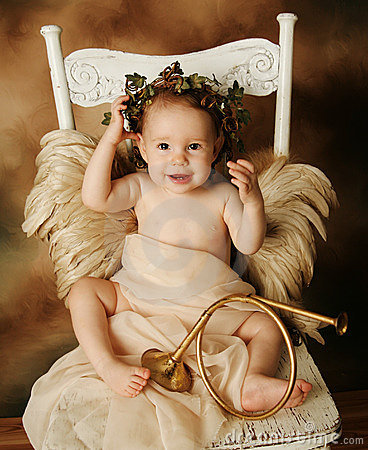 Free Little Gold And Brown Angel Child With A Gold Horn Stock Photos - 18224093