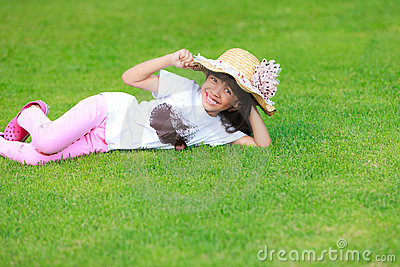Little gril on green grass