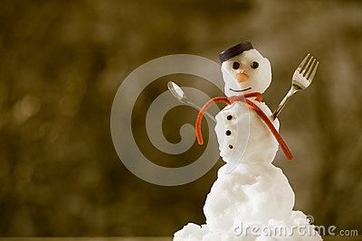 Little happy christmas snowman with fork outdoor. Winter season. Stock Photo