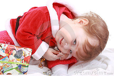 Little happy girl in red santa s clothes