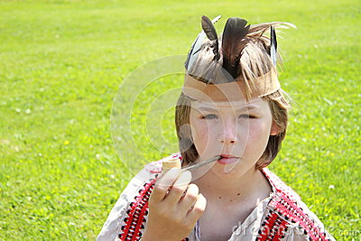 Little indian boy with peace-pipe
