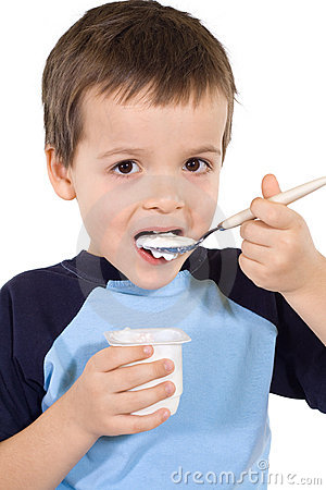 Little kid eating yoghurt