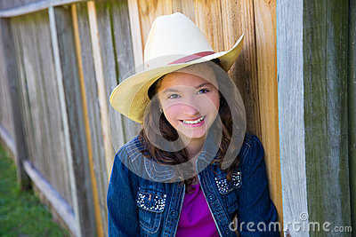 Little kid girl pretending to be a cowboy with hat