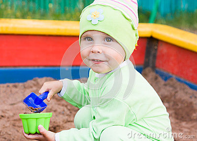 Little kid playing in a sandbox