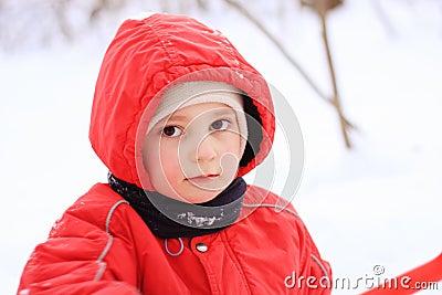 Little kid in red jacket